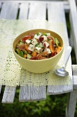 Melon salad with feta cheese and ham