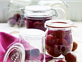 Red gooseberry compote in preserving jars