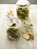 Gherkins in a jar with dill and onions