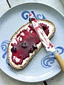 Bread with redcurrant jam