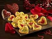 Puff pastry hearts with pistachios and glace cherries