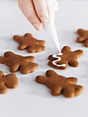 Gingerbread men being decorated