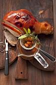 Crispy leg of cochon de lait with a hops and malt sauce