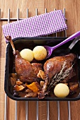 Roast goose legs with plum and apple sauce