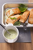 Roasted salmon fillets with a basil and butter sauce