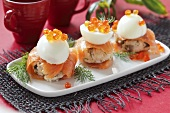 Rice canapes with smoked salmon, egg and caviar