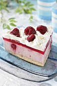 A slice of raspberry cream cake