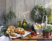 An arrangement of rosemary: food, a wreath and potted rosemary