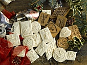 Various Springerle (German Christmas shortcrust biscuits), cutters and gift ribbon