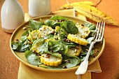 Spinach salad with sweetcorn and pine nuts
