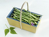 A wooden basket of French beans
