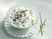 Cottage cheese with chives and chive flowers