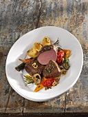 Saddle of lamb with oven-baked vegetables