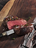 Roast fillet of beef on a wooden board