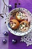 Three egg shells filled with sugar eggs