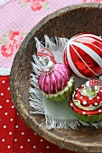 Christmas decorations in a wooden bowl