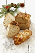 Various types of bread, a plaited loaf and Christmas decorations
