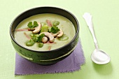 Creamy broad bean soup with ham and mushrooms