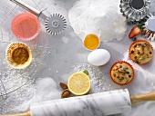 Baking ingredients, baking utensils and muffins