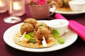 Turkey kofta with pita bread and a yogurt dip