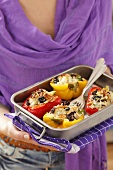 Stuffed peppers with rice, dried tomatoes, olives, pine nuts and feta
