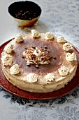 Layered tart with mocca creme decorated with whipped cream