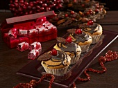 Muffins with chocolate decoration and glace cherries