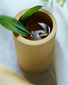 Ramson tea in a wooden cup