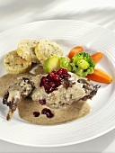 Roast hare with cranberries, napkin dumplings & vegetables