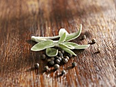 Sage leaves and peppercorns