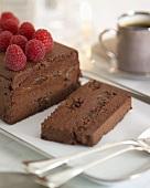 Chocolate and prune terrine with raspberries