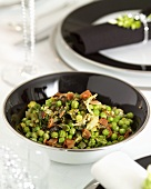 Peas with spring onions and bacon