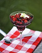 Berry compote with yoghurt and basil sugar