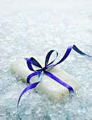 Frozen fish with bow on crushed ice