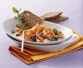 Carrot salad with pine nuts and yoghurt sauce