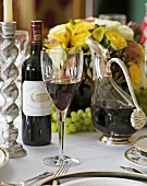 Red wine on table laid for special occasion