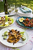 Grilled prawn kebabs, lamb kebabs & salad leaves with pear