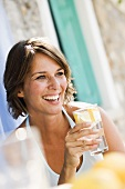 Woman with a glass of lemonade