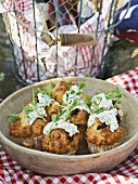 Savoury muffins with olives and herb soft cheese