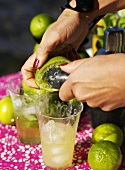 Squeezing a lime for a cocktail