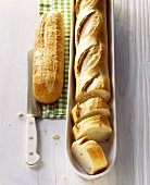 Whole and partly sliced baguettes