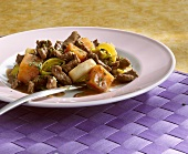 Pieces of ostrich meat with sweet potatoes and leeks