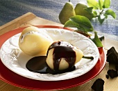 Pears stuffed with quark with chocolate sauce