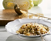 White cabbage with millet and bacon