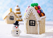 Gingerbread house with chocolate beans and snowman