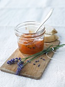 Apricot and lavender jam in jar with spoon