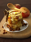 Winter jam made with apples and raisins in preserving jar