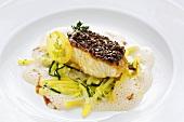 Braised catfish on potatoes & leeks with truffle & sauce verjus