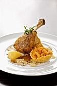 Roasted goose leg with baked pumpkin and chestnut