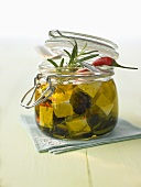 Pickled sheep's cheese with chillies and rosemary